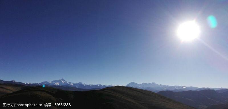 山坡连绵大山日落风光图片