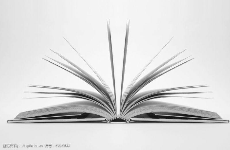 茶杯打开的书籍图片